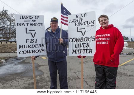 Father And Son Holding Signs.