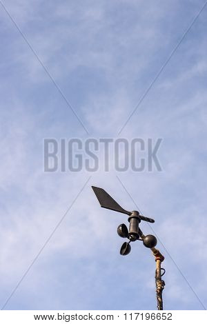 Anemometer with the cloud in the sky