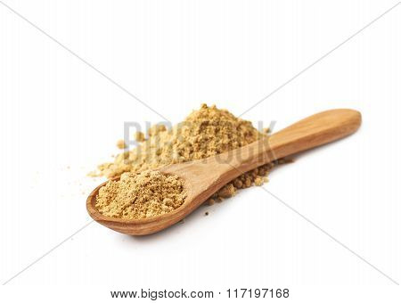 Pile of dry ginger powder isolated