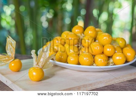 Orange Organic Cape Gooseberries In A Plate On Wooden
