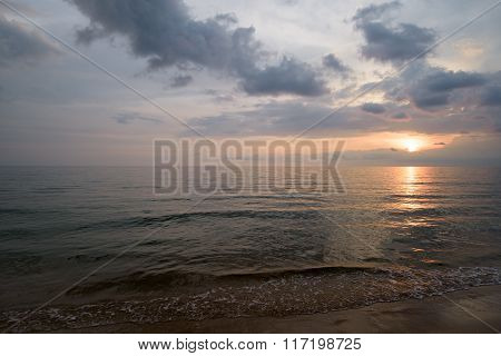 Sunset Over Ocean Showing Wave Formations And Cloud Formations