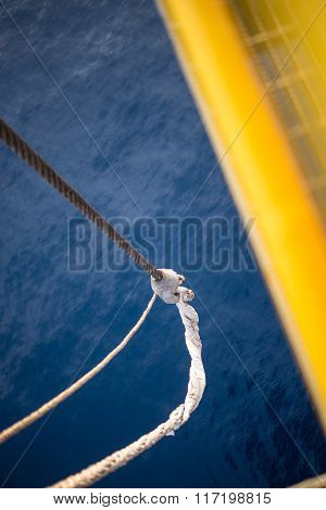 jack up oil rig's supply boat tie up rope with the ocean