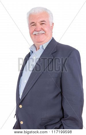 Happy Mature Man With Hands In Pockets