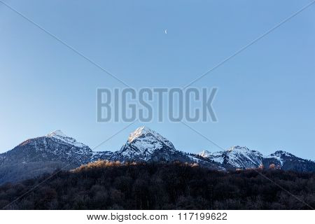 Moon In The Sky Above The Peaks