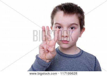 Serious Boy With Three Fingers Up