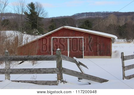 Barn with fence in winter