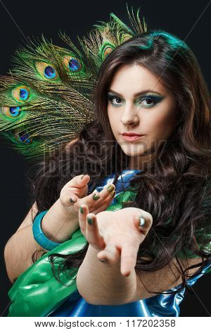 Close Up Beauty Portrait Of Beautiful Girl With Peacock Feather, Lures, Beckoning Hands. Makeup