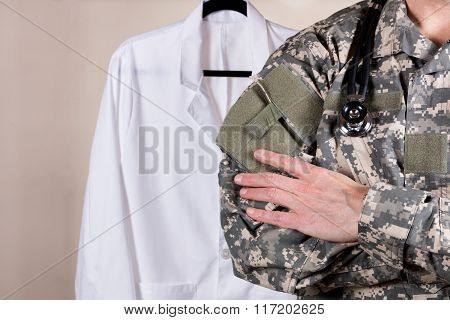 Medical Military Doctor With White Consultation Coat In Background