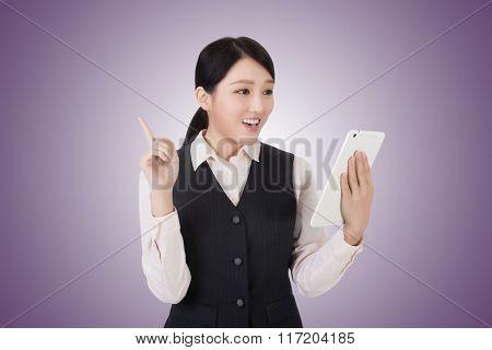 asian young business woman using pad, closeup portrait