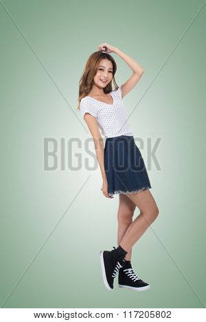 Young Asian girl, full length portrait isolated.