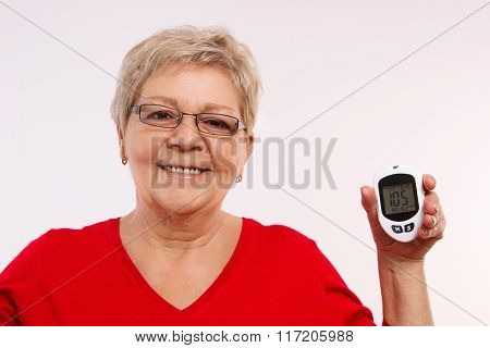 Happy Senior Woman Holding Glucometer, Measuring And Checking Sugar Level, Concept Of Diabetes In Ol
