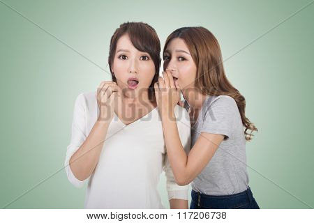 Asian friends' whisper, full length portrait.