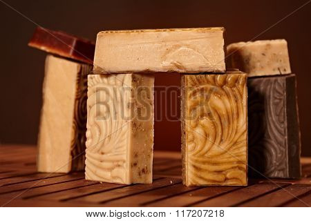 Variety of organic soap bars in artistic arrangement.