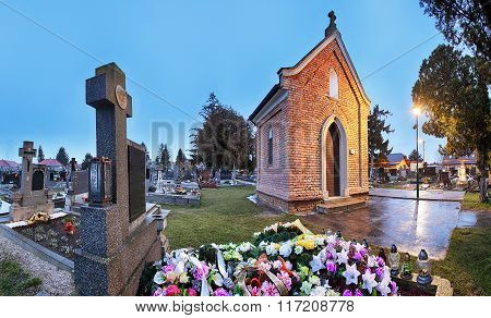 Cemetery Panorama At Night With Chapel And Flowers