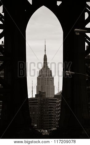 NEW YORK CITY, NY - JUL 11: Empire State Building through Manhattan Bridge on July 11, 2014 in New York City. It is a 102-story landmark and was world's tallest building for more than 40 years.