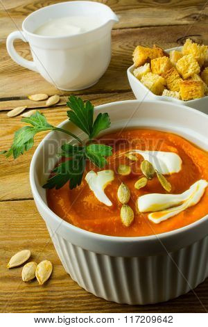 Pumpkin Soup With Cream On The Dark Wooden Background