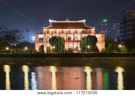 The Ho Chi Minh Museum on the banks of the river at night. Ho Chi Minh City, Vietnam