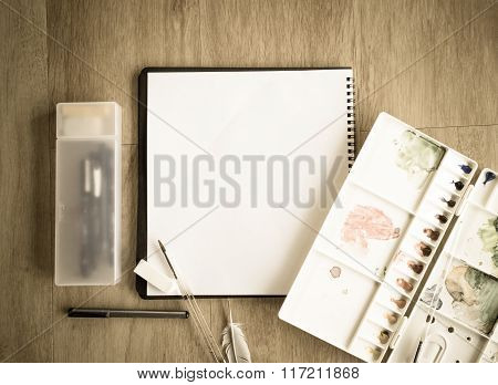 Top View Of Notebook And Artist Color Palette On Wood Floor Vintage Picture Style