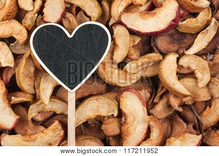 Pointer In The Form Of Heart Lies On Dry Apple