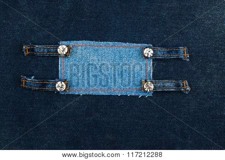 Frame With Four Straps Jeans And Rhinestones, Lies On The Dark Denim