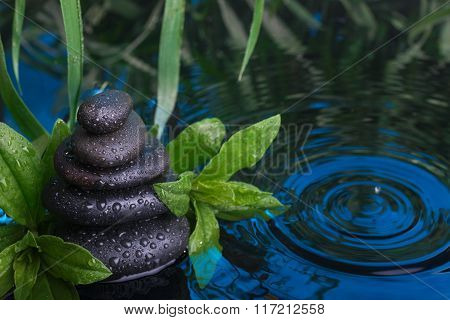 Spa Still Life With Stone Pyramid Reflecting In Water