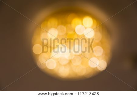 Blurred Photo Of Ceiling Chandelier In Warm Color Light