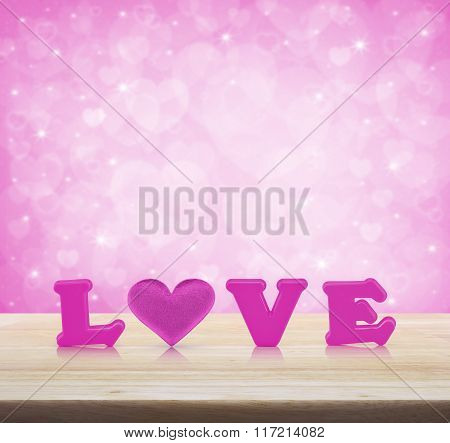 Pink Love Alphabet And Fabric Heart On Wooden Table Over Light Pink Heart Bokeh Background, Valentin