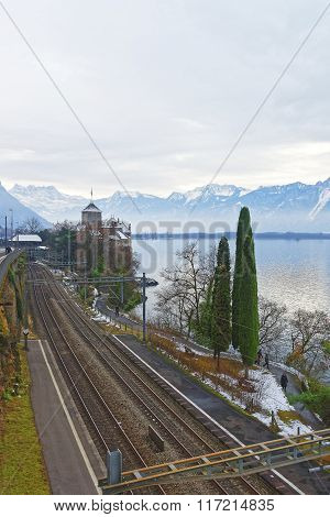 VEYTAUX SWITZERLAND - JANUARY 2 2015: View to the Chillon Castle from the bridge. It is island castle on Lake Geneva (Lac Leman) in the Vaud between Montreux and Villeneuve.