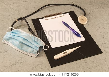 table doctor, thermometer, stethoscope, mask, ballpoint pen, tablet for writing