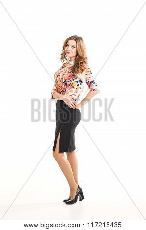 beautiful young blonde woman in office clothes on a white background