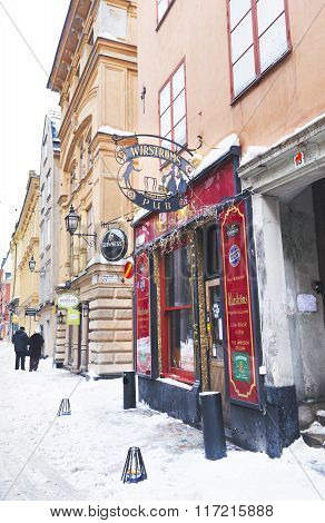 STOCKHOLM, SWEDEN JANUARY 5, 2011: Pub in winter Gamla Stan in Stockholm. Stockholm is the capital of Sweden and the most populous city in the Nordic countries.