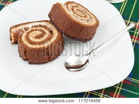Two Chocolate Roll On A Plate
