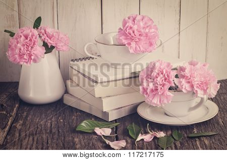 Pink Carnation Flowers In White Tea Cup