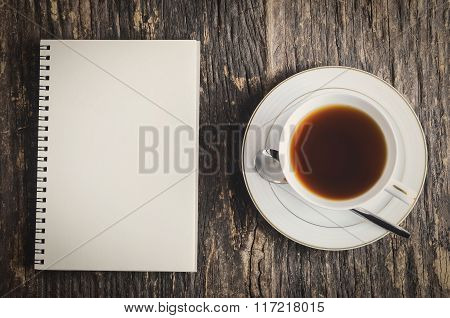 White Notebook And Cup Of Tea