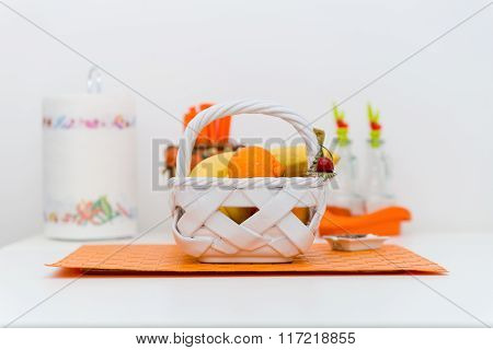 Interior Of Small White Kitchen With Fresh Fruit Basket On The White Table