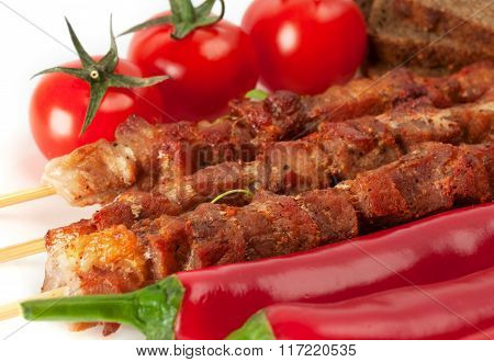 Shish Kebab On Bamboo Sticks With Cherry Tomatoes