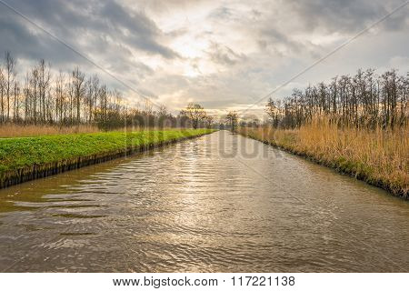 Long Straight Canal Through A Nature Area In Autumn