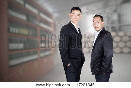 Two Business Man Standing With Winery Background