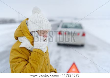 A Woman In Winter Calls To The Emergency Services.