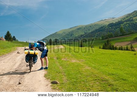 Tired cyclist. Biking in the Carpathians