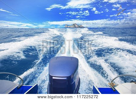 rear view of speed boat running over blue sea