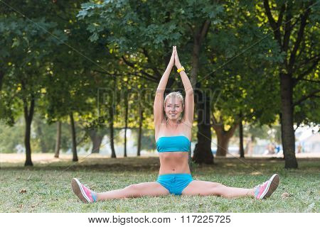 Young Woman Doing Sport Exercise In The Park