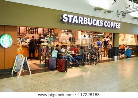PRAGUE, CZECH REPUBLIC - AUGUST 18, 2015: Starbucks cafe interior. Starbucks Corporation is an American global coffee company and coffeehouse chain based in Seattle, Washington