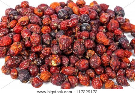 Pile Of Dried Rose Hips Isolated On White Background