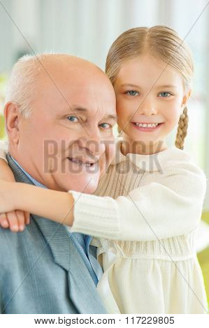 Grandfather having great time with little granddaughter.