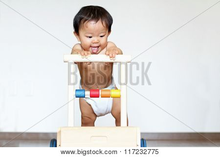 Japanese baby boy pushing a cart (0 year old)