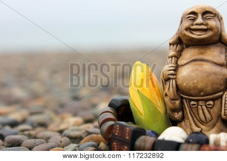 Bracelet And Flower With Budda Figurine