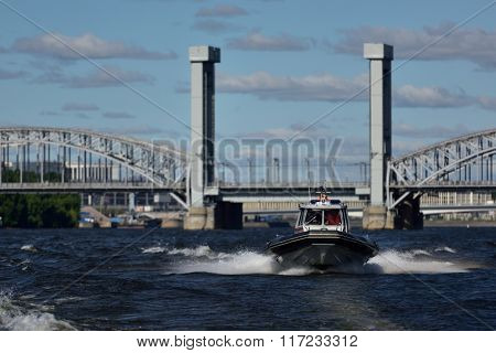 ST. PETERSBURG, RUSSIA - AUGUST 15, 2015: Search and Rescue Service boat during the River marathon Oreshek Fortress race. This international motorboat competitions is held since 2003