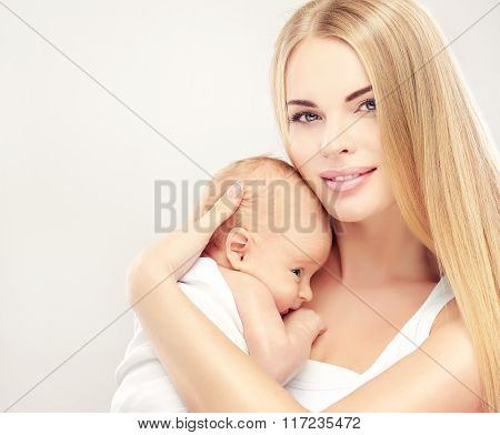 Portrait of happy mother and baby . Smiling Woman with her newborn baby