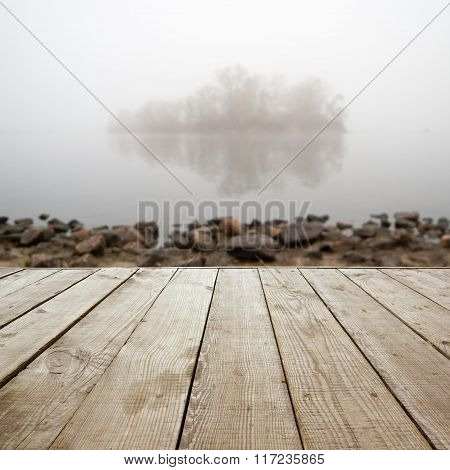 Wooden perspective floor with planks on blurred natural autumn